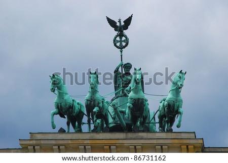 Quadriga sculpture on top of the famous  Brandenburger Tor, Berlin, Germany - stock photo