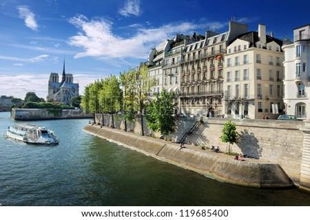 Quai d'Orleans, cathedral Notre Dame de Paris and river Seine in Paris, France. - stock photo