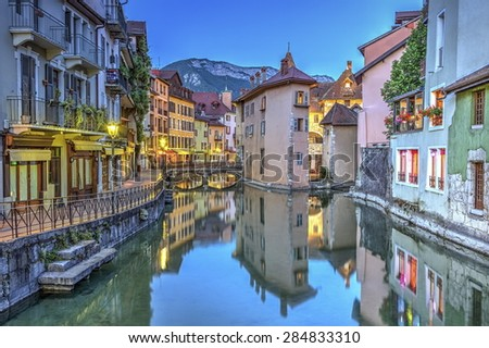 Quai de l'Ile and canal in Annecy old city by night, France, HDR - stock photo