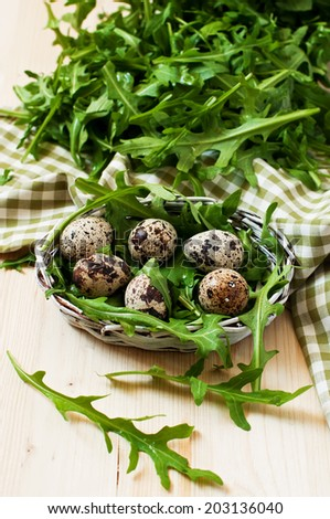 quail eggs and  green salad - stock photo