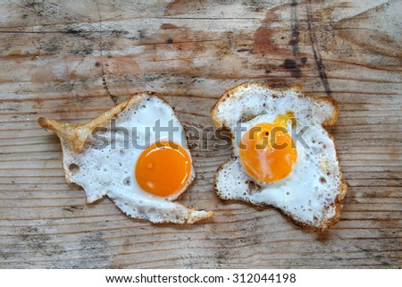 quail eggs - fried eggs on an old rustic table of wood - wooden background