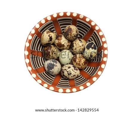 Quail eggs in a ceramic plate isolated on white background - stock photo