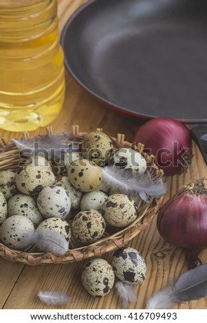 Quail eggs in a wicker basket in the kitchen in the village.Selective focus