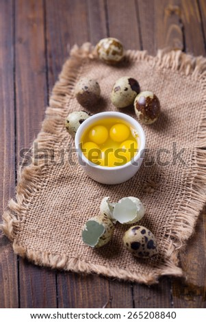 Quail  eggs on dark painted wooden background. Selective focus. - stock photo