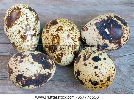 quail eggs on wood