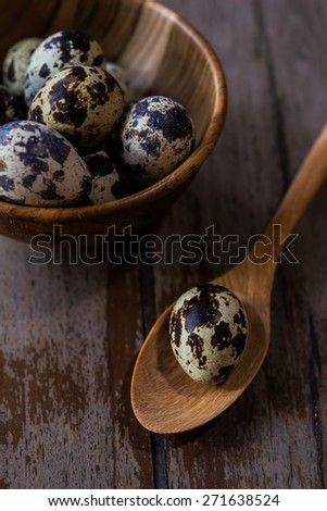 quail eggs on wood backgrounds - stock photo
