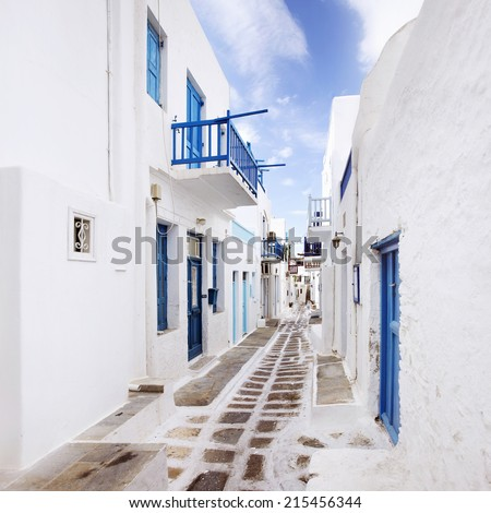 Quaint, colorful street in Mykonos, Greece. Square Crop - stock photo