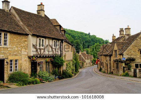 Quaint town of Castle Combe in the Cotswolds of England - stock photo