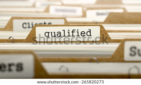 Qualified Concept. Word on Folder Register of Card Index. Selective Focus.