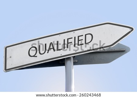 QUALIFIED word on road sign - stock photo