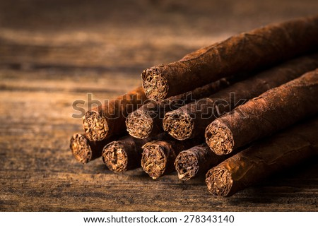 quality cigars for relaxing on an old wooden table - stock photo