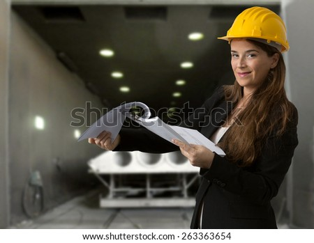 quality control against industrial factory background - stock photo