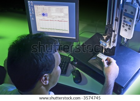 Quality control technician measuring various small objects for quality issues