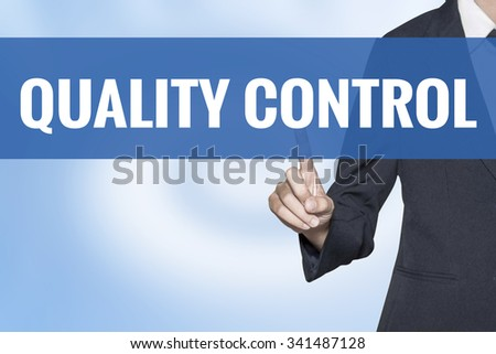 Quality Control word on virtual screen touch by business woman blue background - stock photo
