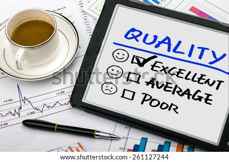 quality evaluation concept on tablet pc - stock photo