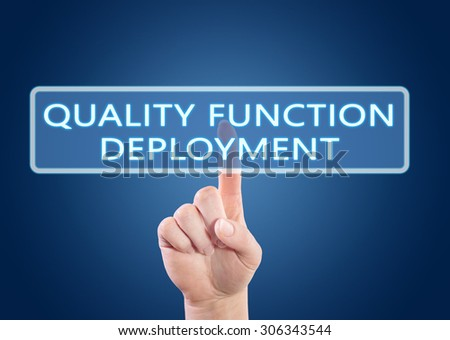 Quality Function Deployment - hand pressing button on interface with blue background. - stock photo