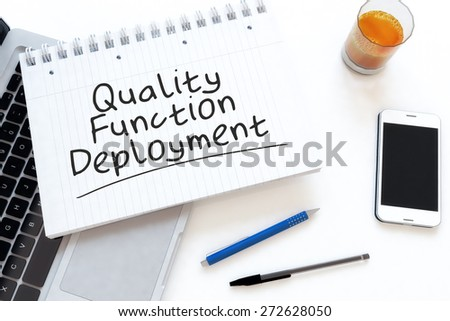 Quality Function Deployment - handwritten text in a notebook on a desk - 3d render illustration. - stock photo