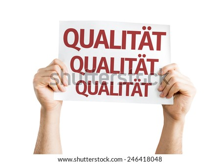 Quality (in German) card isolated on white background - stock photo