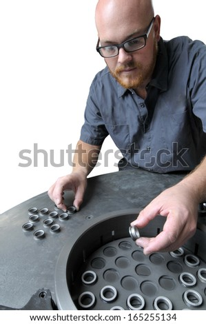 Quality Inspector in a Precision Machine Shop checking manufactured parts isolated on a white background - stock photo