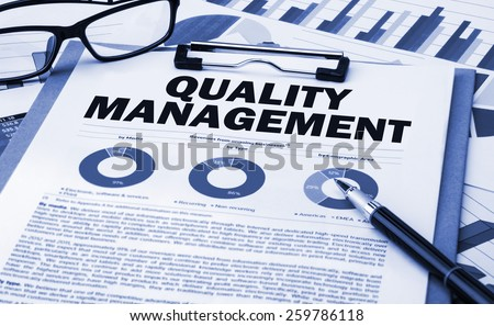 quality management concept on clipboard - stock photo