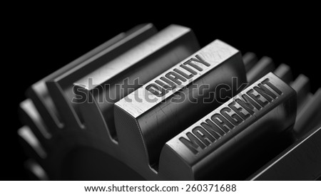 Quality Management on the Metal Gears on Black Background.  - stock photo