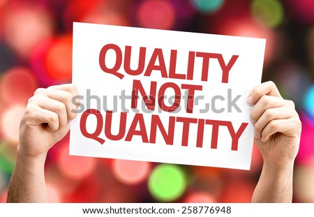 Quality Not Quantity card with colorful background with defocused lights - stock photo