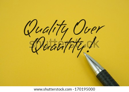 Quality Over Quantity note with pen on yellow background