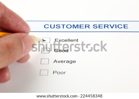 Quality survey and human hand with pencil. - stock photo