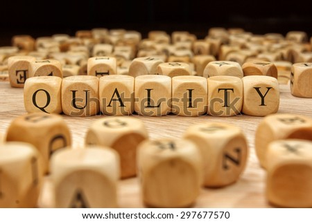 QUALITY  word written on wood block - stock photo