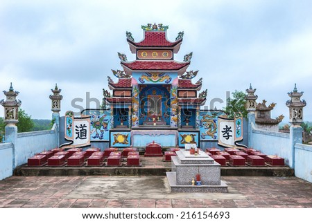 QUANG BINH, VIETNAM - CIRCA MARCH 2012: Monumental shrine fronted by small tombs form the family plot at cemetery.