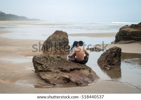 QUANG BINH, Vietnam, July 24, 2016 couple, sitting watching the sea, rocks, coastline Quang Binh, central Vietnam