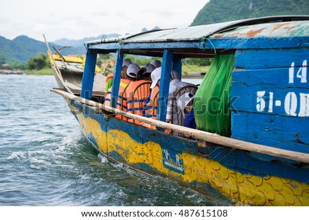 Quang Binh, Vietnam - June 16, 2016: Closeup Semi power/rowing tourism boat on river to Phong Nha cave, Phong Nha - Ke Bang national park, Quang Binh, Vietnam
