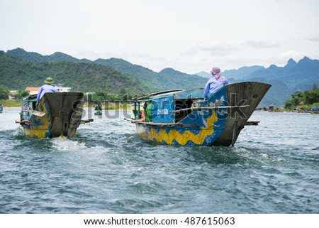 Quang Binh, Vietnam - June 16, 2016: Semi power/rowing tourism boat on river to Phong Nha cave, Phong Nha - Ke Bang national park, Quang Binh, Vietnam