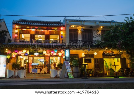 Quang Nam, Vietnam - Apr 1, 2016: Hoi An ancient town by twilight period by Minh Khai street. Hoi An is UNESCO world heritage, one of the most popular destinations in Vietnam