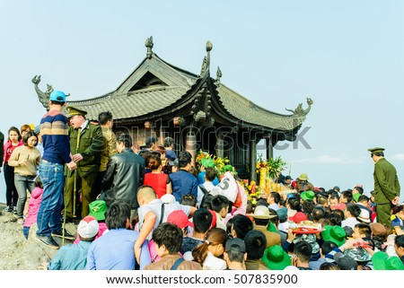QUANG NINH, VIETNAM, February 21, 2016: crowded tourists visited Pagoda on Yen Tu mountain high, Quang Ninh province, Vietnam, the construction of copper, Tran Nhan Tong King Cathedral, Vietnam