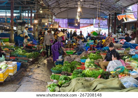 Quang Ninh, Vietnam - Mar 22, 2015: View of Ha Long rural market with vegetable stalls