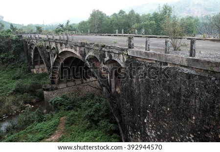 QUANG TRI, VIET NAM- FEB 23, 2016: Dau Mau bridge on Ho Chi Minh trail, an old bridge link with Vietnam war history make by French locate at Cam Lo, with amazing architect, pass green jungle