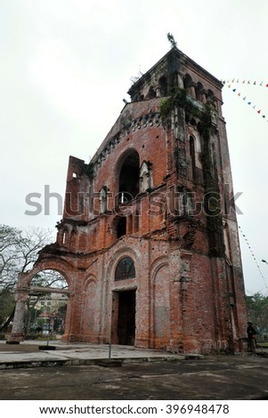QUANG TRI, VIET NAM- FEB 20, 2016: Old church at La Vang holy land with ancient red brick wall, a place for Christian faithful to go pilgrimage, amazing old architect at Quangtri, Vietnam