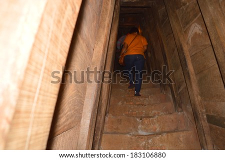 QUANG TRI, VIETNAM - MARCH 13 : Tourists walk into Vinh Moc underground tunnel used during B52 carpet bombing between Vietnam war on March 13, 2014 in Quang Tri, Vietnam.