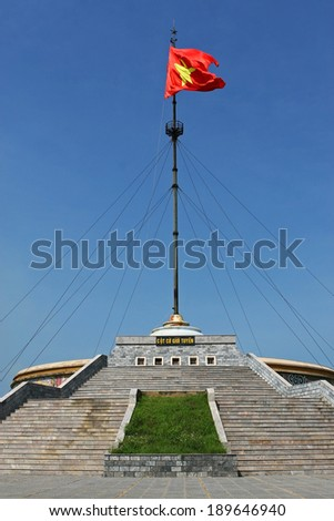 QUANG TRI, VIETNAM - SEPT 13, 2009: Vietnamese flag flying on flag-tower on the side of Ben Hai river. This historical river was the border line between north and south Vietnam in the war before 1975.
