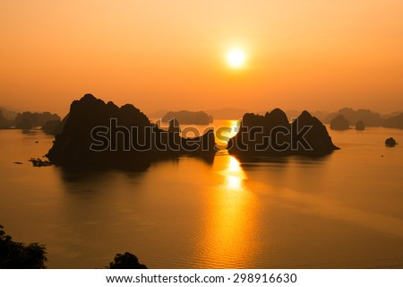 QUANGNINH, VIETNAM, July 12, 2015. Beautiful sunrise in Halong bay. Halong bay is World Natural Heritage of Quang Ninh, Vietnam.