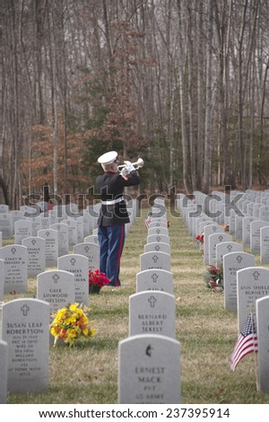 QUANTICO, VA-DEC 13, 2014: Quantico National Cemetery wreath laying event on Dec 13. Wreaths Across America , a non profit organization, placed wreaths after a ceremony that included the playing of taps - stock photo
