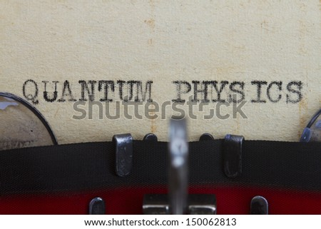 Quantum physics type written in a vintage paper.