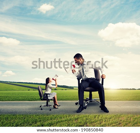 quarrel between angry big man and screaming small woman on the road - stock photo