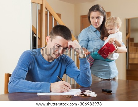 Quarrel in the family over money at home - stock photo