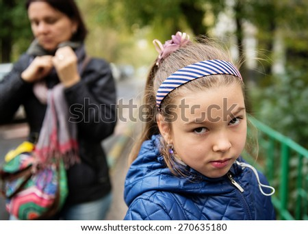 Quarrel. Mom and her sad daughter.  - stock photo