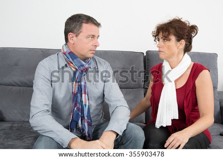 quarreled middle aged couple in their living room at home