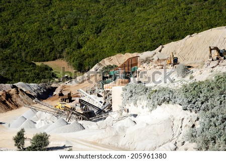 Quarry inert material with all the necessary machinery for the production/Quarry inert material - stock photo