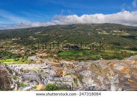 Quarry mine in a landscape. Extraction resources. - stock photo