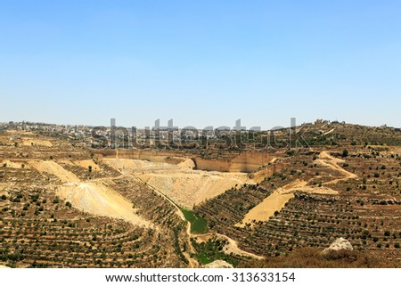 Quarry, olive groves near the city of Hebron, Israel - stock photo